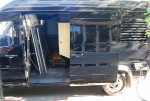 Film silenced generator van - storage bay
